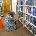 A library borrower choosing books